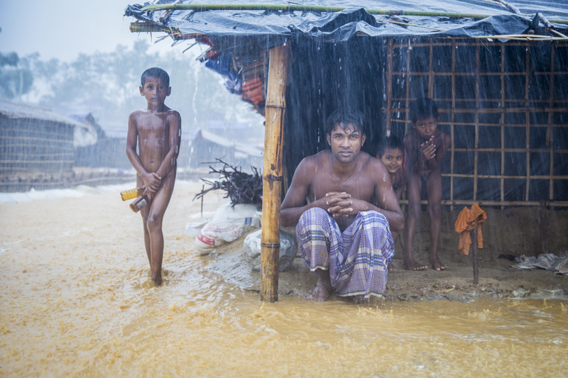 Bangladesh, Myanmar, Family in rain, 2017 © Humberto Tan.